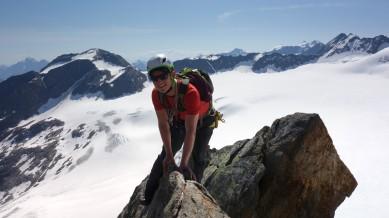 astride ridge climbing